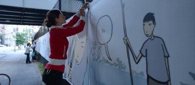 Danica Novgorodoff hanging a panel from her upcoming graphic novel...