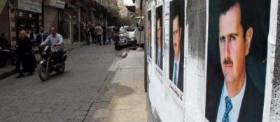 Posters of Bashar al-Assad in Damascus.
