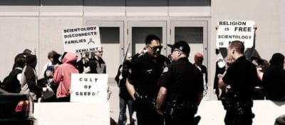 """""""2008-03-15 Anonymous Hollywood Scientology protest"""" by Jason Scragz, via Flickr."""